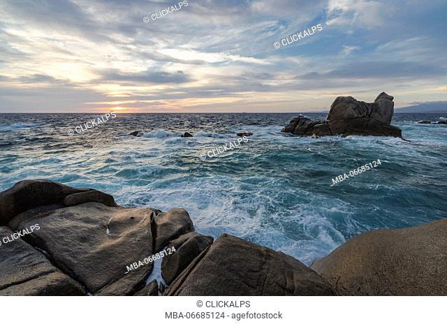 The light of sunset over the blue sea framed by cliffs Capo Testa Santa Teresa di Gallura Sassari Province Sardinia Italy Europe