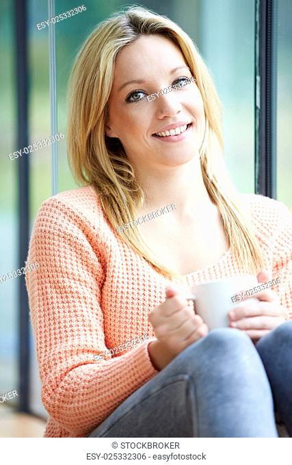 Teenage Girl Relaxing At Home With Hot Drink