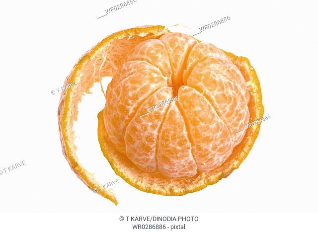 Fruits , half peeled off juicy orange on white background