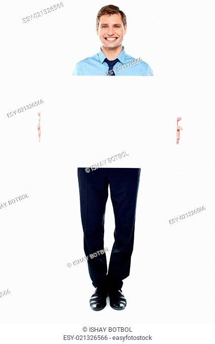Businessman holding blank white billboard