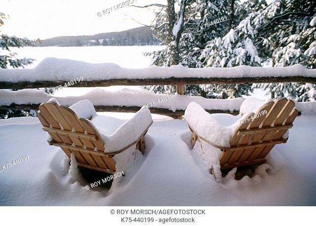 Snowcovered Adirondack chairs