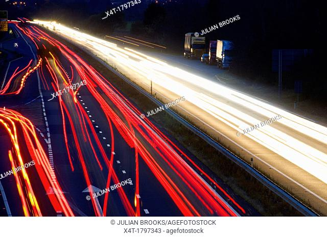 light trails at night on a main road junction