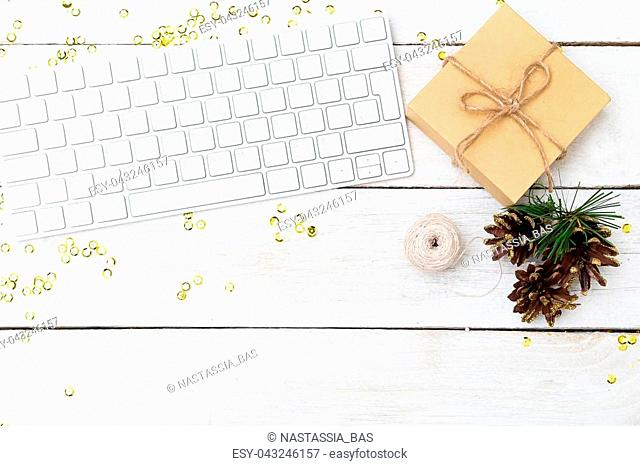 Christmas background. Desktop with keyboard and Christmas decorations