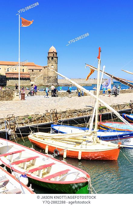 Traditional boats moored at the Port dâ. . Avall with the Church of Notre Dame des Anges behind, Collioure, Côte Vermeille, Céret, Pyrénées-Orientales