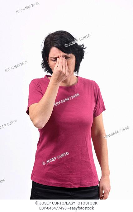 middle aged woman with pain on nose on white background