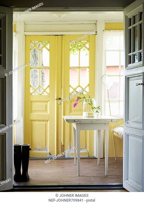 A yellow glass-enclosed veranda, Sweden