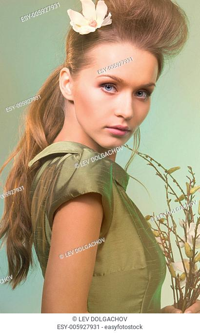 pale picture of beautiful woman over green background