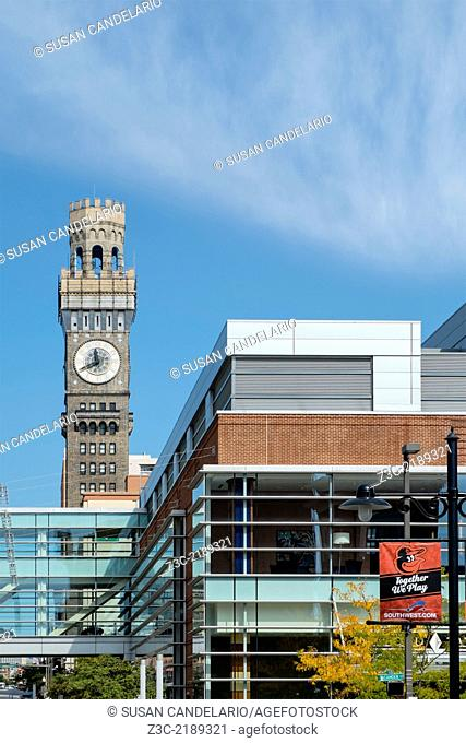 A view from Eutaw Street on a nice afternoon with a blue sky with whispy clouds to the Emerson Bromo-Seltzer Tower in Baltimore, Maryland