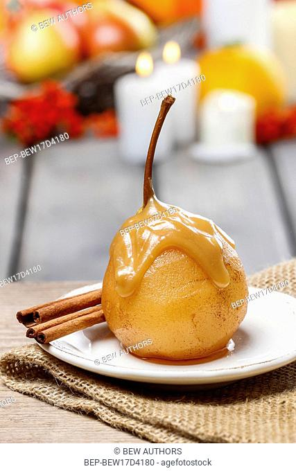 Pear with caramel sauce. French dessert