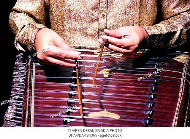 man playing musical Instrument santoor India