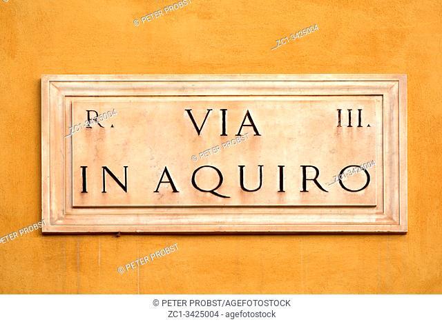 Street sign the Via in Aquiro in Rome - Italy