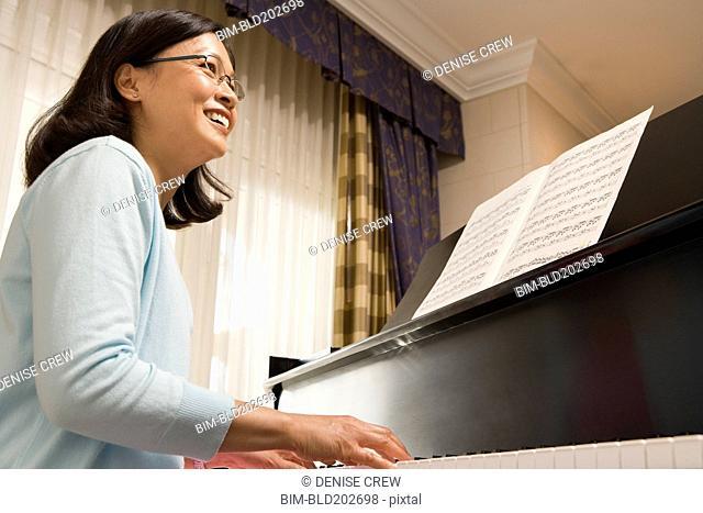 Chinese woman playing piano