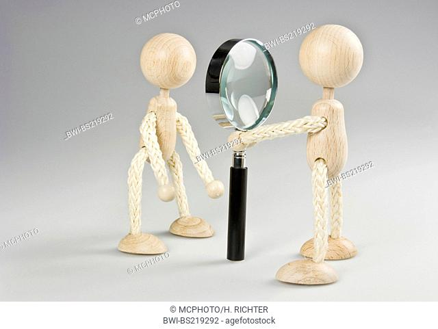 identity check, security check, person is examined by an magnifying glass