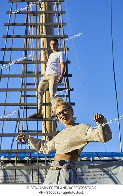 Australia, Adelaide, Fashion Blogger and actress Sarah Jeavons in front of mast with man (Reno Marrasso), feelings, sensitive, couple, thoughtful, cool attitude