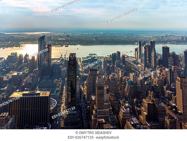 New York City Manhattan skyline aerial view with Hudson river and skyscrapers at sunset