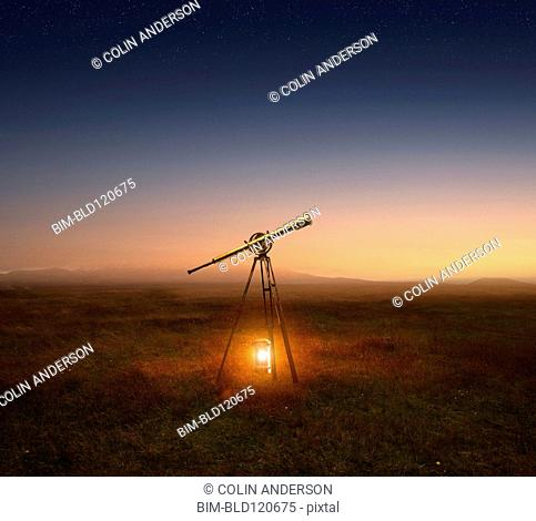 Lantern and telescope in rural field
