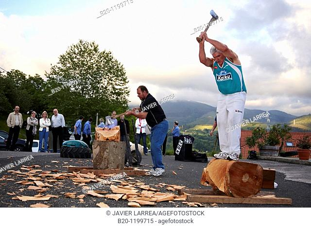 Luis Txapartegi, Aizkolari (wood-chopping), and Iñaki Perurena, Basque rural sport, Aduna, Gipuzkoa, Basque Country, Spain