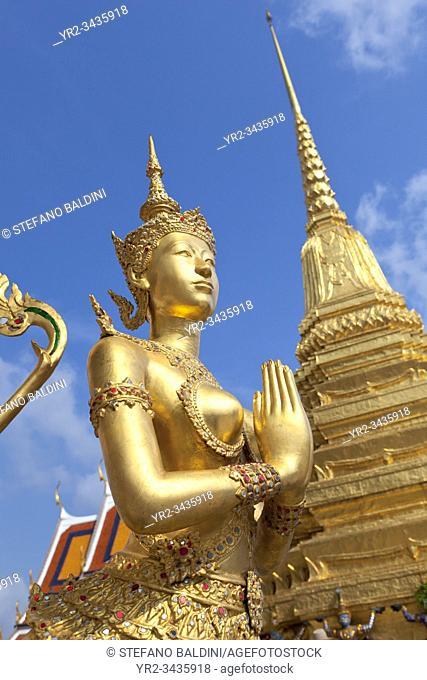Statue of Kinnari, traditional symbol of feminine beauty at Wat Phra Kaeo, the Royal Grand Palace, Bangkok, Thailand