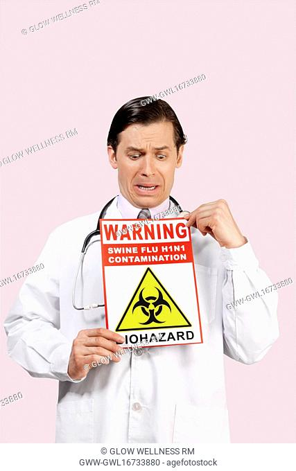 Doctor showing a Biohazard warning sign and crying