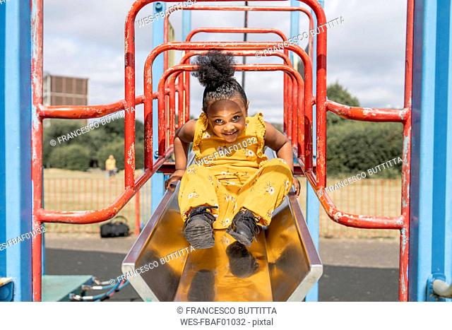 Portrait of a smiling girl on a playground