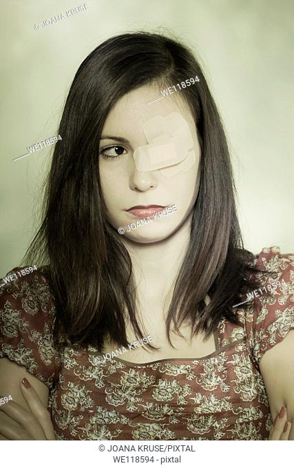 a girl with patches on one of her eyes