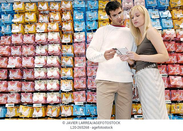 Couple buying light bulbs at shopping center