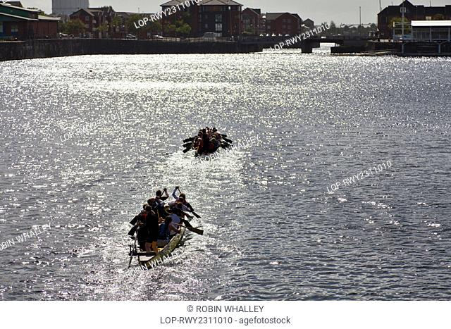England, Merseyside, Liverpool. A Dragon boat training session in Queen's Dock