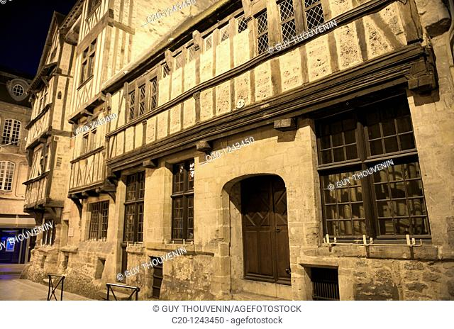 Half-timbered house (14th century) at night in the corner of Cuisiniers and St Martin streets: it's one of the most ancient houses in Normandy