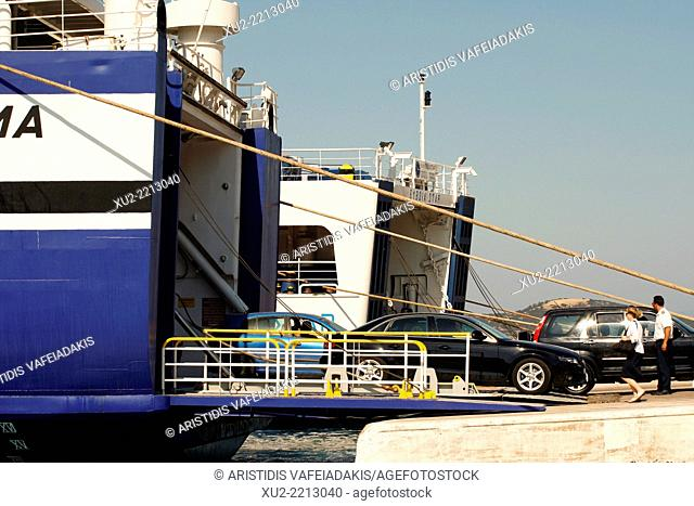 Passengers and cars embarking and disembarking from a Greek ferry in the harbour of Marmari in Evia, Greece