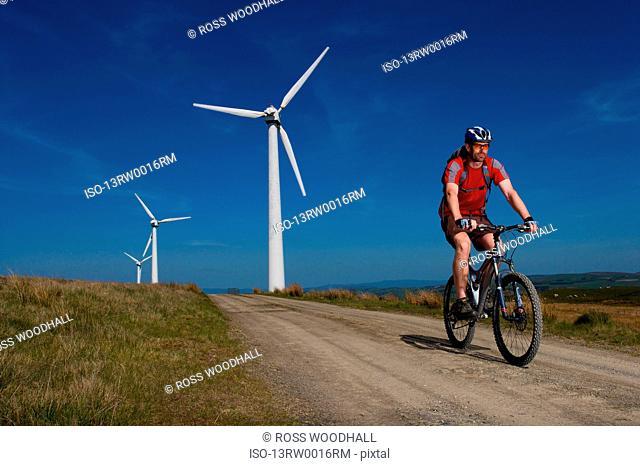 Mountain biker at a wind farm