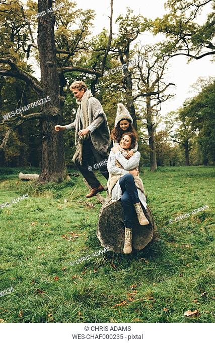 Happy family spending time together in an autumnal park