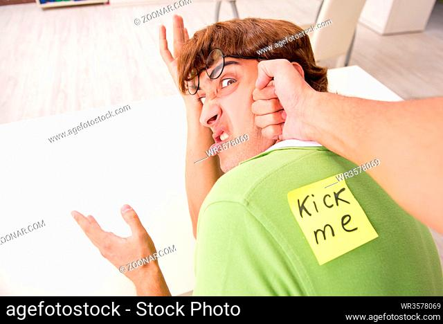 Office prank with kick me message on sticky note