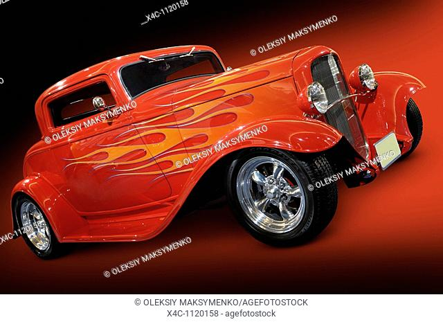 Red Hot rod Ford 3-window coupe 1932 retro car with flame pattern painted on it Isolated with clipping path on black red background