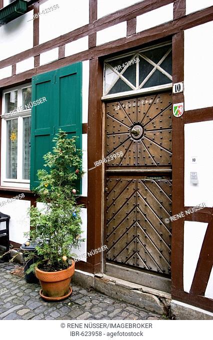 Wooden door of a Fachwerk house, protected landmark, Monschau an der Eifel, Aachen, North Rhine-Westphalia, Germany, Europe