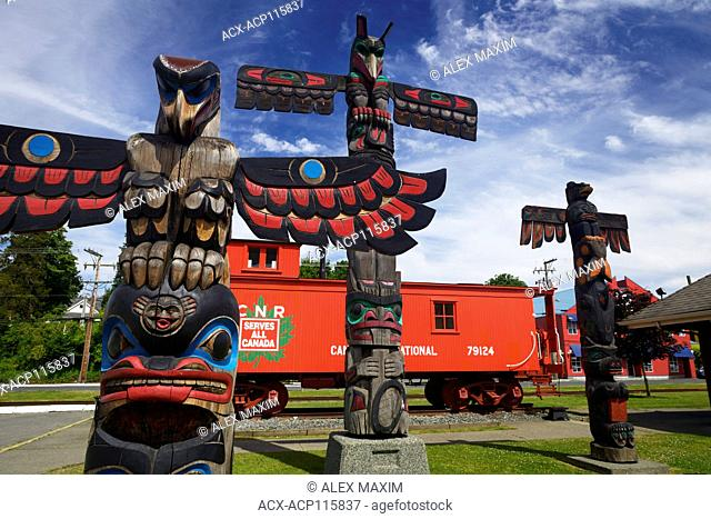 Colorful totem poles and CNR train car in downtown Duncan, City of Totems, Cowichan Valley, Vancouver Island, British Columbia, Canada 2017