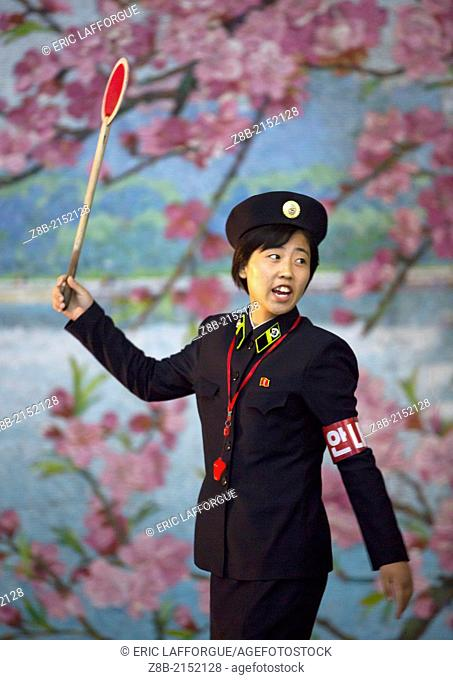A Woman Guard Signals As A Train Arrives In The Subway, Pyongyang, North Korea
