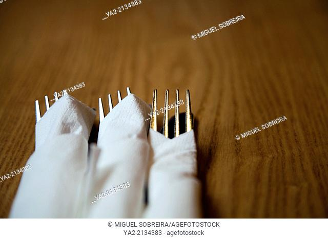 Knives and Forks Wrapped in Napkins at restaurant