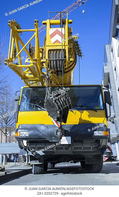 Mobile crane at construction site. Mounting crane process