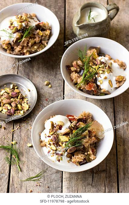 Aubergine pilau with yoghurt, dill and pistachio nuts