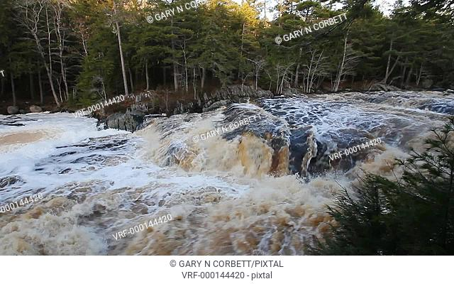Water flowing over Mill Falls in Kejimkujik National Park in Nova Scotia Canada