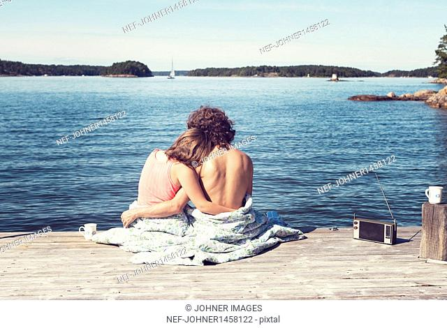 Couple embracing on jetty