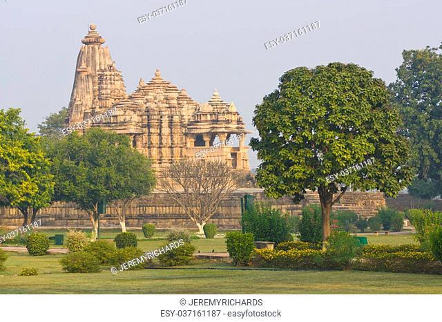 Ancient Chitragupta Hindu Temple set in landscaped gardens at Khajuraho, Uttar Pradesh, India. 11th Century AD