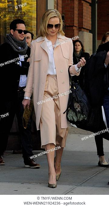 Katherine Heigl leaving her hotel in Manhattan wearing sunglasses, long peach coat, cropped trousers and gold patterned shoes Featuring: Katherine Heigl Where:...