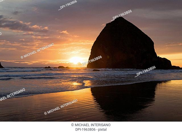 silhouette of haystack rock at sunset, cannon beach, oregon, united states of america