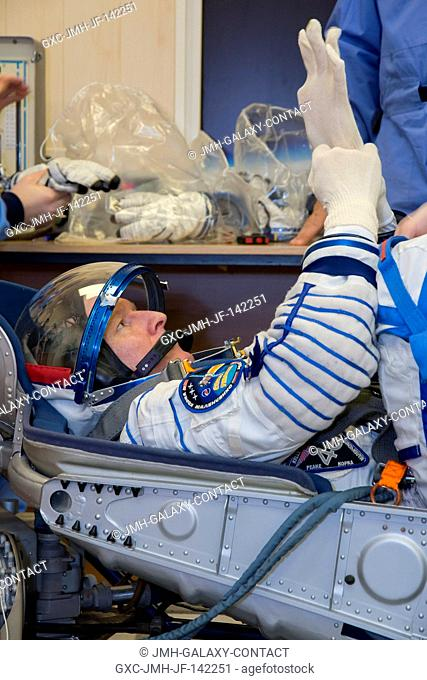 In the Integration Facility at the Baikonur Cosmodrome in Kazakhstan, Expedition 46-47 crewmember Tim Peake of the European Space Agency conducts a pressure and...