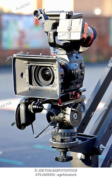 canon eos C movie tv camera on boom stand