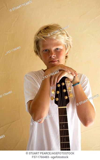 Teenage boy with his guitar