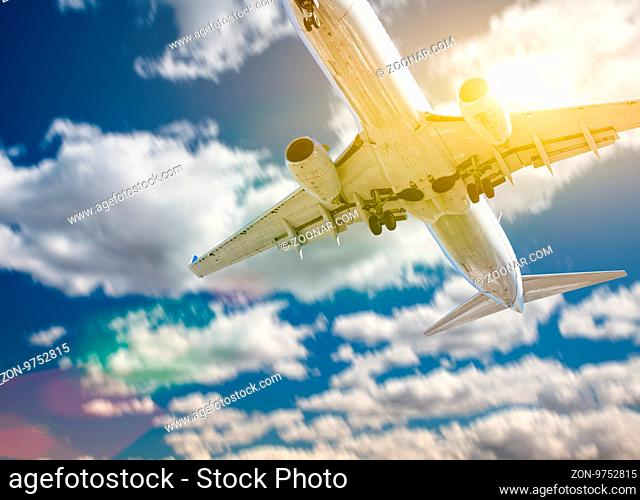 Jet Airplane Landing with Dramatic Clouds and Sky Behind