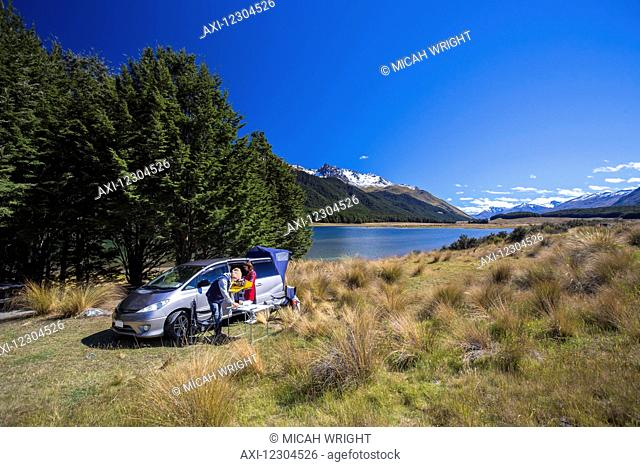 A couple in a campervan sets up camp alongside Mavora Lake; Mavora, Southland, New Zealand