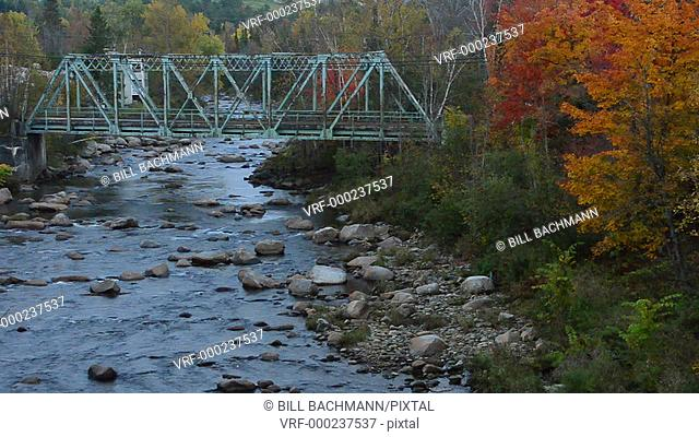 Bethlehem New Hampshire old train bridge built in 1920 over river in Northern New England in fall foliage in October